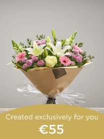 Hand tied bouquet made with seasonal flowers