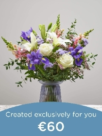 Hand tied bouquet and vase made with seasonal flowers.