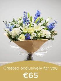 Hand tied bouquet made with seasonal flowers.